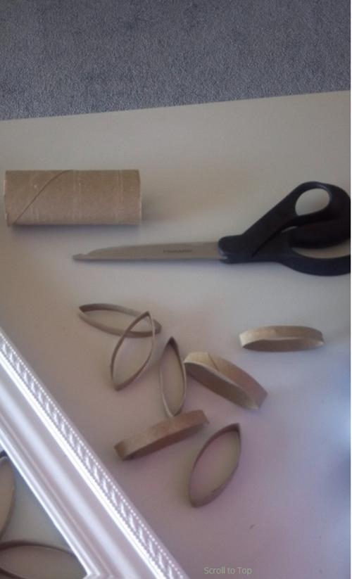 Empieza cortando rollos de papel higienico en tiras y empieza a pulverizar pintura 03
