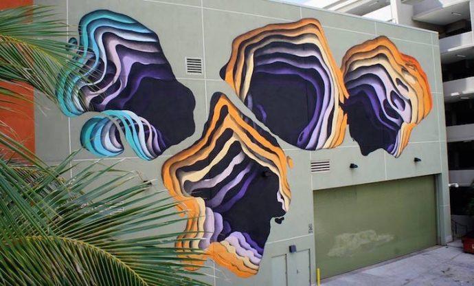 Artista callejero pinta grafitis de ilusiones ópticas en los edificios