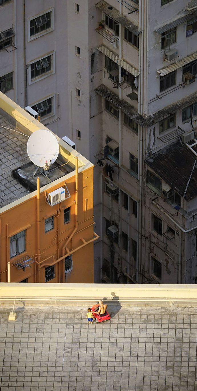 12 Imágenes de personas pilladas in fraganti en las terrazas y tejados de Hong Kong
